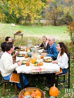 Set up a table outside so guests can eat in the crisp autumn air. Top a table with burlap tablecloth. (Try making your own by purchasing a length of burlap to fit your table and fraying the edges.) Dress up the table top with a cozy runner, miniature gourds and pumpkins, and candles inside large glass hurricanes.