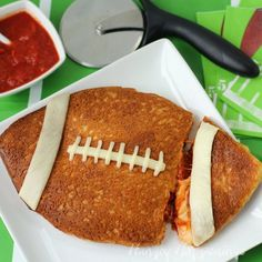 Make a Stuffed Pizza Football for all the fans at your Super Bowl Party. It's super easy and super fun. | HungryHappenings.com