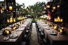 Outdoor wedding reception with candles and lanterns.