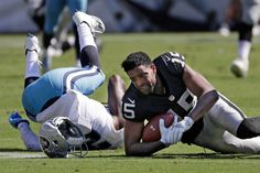 Oakland Raiders wide receiver Michael Crabtree (15) loses his helmet after catching a pass as he was defended by Tennessee Titans strong safety Da'Norris Searcy, left, in the second half of an NFL football game Sunday, Sept. 25, 2016, in Nashville, Tenn. (AP Photo/James Kenney)