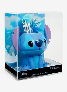 But that's not all — it comes with a brush holder shaped like Stitch himself. - Disney Lilo & Stitch Makeup Brush SetDisney Lilo & Stitch Makeup Brush Set, Best Picture For Skinc - Lelo And Stitch, Lilo Et Stitch, Stitches Makeup, Stitch Disney, Cute Stitch, Stitch Toy, Cute Makeup, Makeup Set, Ikea Makeup
