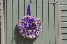 Purple and cream material and tulle wreath I made using ideas from Pinterest :)