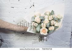 Very beautiful flowers in a bouquet shot by a macro shot, the best gift for a girl is a gorgeous bouquet of flowers.A bouquet of flowers on an elongated hand