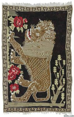 Vintage Turkish kilim rug with lion design. This interesting kilim was hand-woven in Bardiz in Eastern Turkey in mid-century.