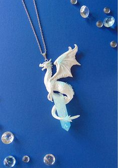 Ice Dragon Necklace - White Dragon Necklace - Polymer Clay Jewelry - Dragon Jewelry - Winter Dragon Pendant - Ice Crystal - Fantasy Jewelry Beautiful handmade ice dragon, sitting on an ice crystal made of resin. Comes with the silver-plated necklace Crystal Necklace, Sterling Silver Necklaces, Pendant Necklace, Crystal Pendant, Pendant Jewelry, Glass Jewelry, Crystal Jewelry, Ice Necklace, Sword Necklace