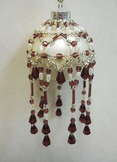 """PATTERN Beaded Ornament Cover """"Victorian Drape"""". Original design from the House of Whispering Firs """"Victorian Drape"""". This beaded cover is a combination of glass seed, bugle (optional freshwater pearls) and faceted beads along with faceted drops. 