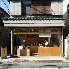 Tokyo rice shop by Schemata Architecture  is filled with boxy plywood fittings