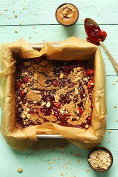 EASY Gluten Free Vegan PB&J Bars! A simple oat-walnut crust, jammy and peanut buttery filling! SO tasty #vegan #glutenfree #pbj #peanutbutter #snack #healthy