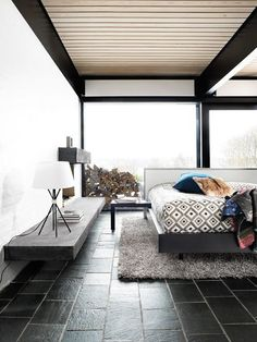 bedroom with cool black tile floors