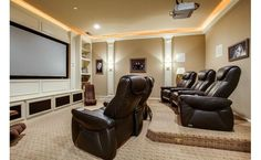 In-home theater room. Definitely wouldn't mind having one of these, or just making the living room into one.