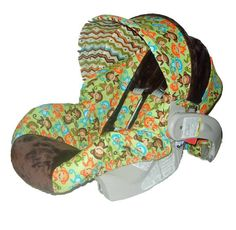 A MONKEY car seat cover!!! I want it if this baby is a boy!