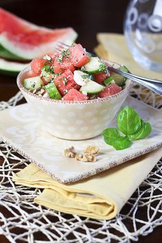"Refreshing Watermelon Cucumber Salad 3 cups watermelon, cut into 1"" cubes 1 seedless cucumber, cut into quarter slices 2 tbsp fresh mint, finely chopped 3 tbsp fresh basil, finely chopped ½ tsp cracked black pepper ¼ tsp salt 3 tbsp white balsamic vinegar (or white wine vinegar) 1 tbsp extra virgin olive oil 50g toasted walnuts, chopped 35g feta cheese, crumbled"