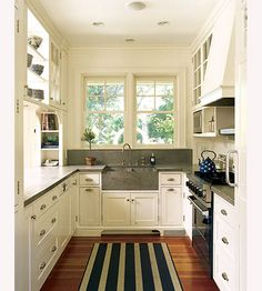pine floors, white cabinets, concrete counter tops, AND a concrete sink.