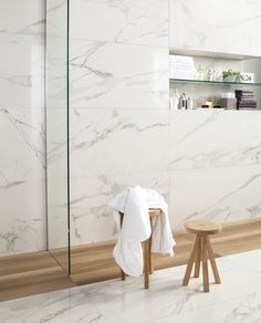 Modern and chic bathroom design. Wood and marble mix to create a lovely atmosphere.
