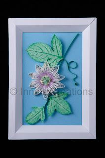 Quilled passionflower in a paper frame