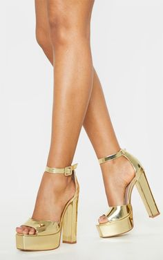 Gold Platform High Sandal Channel studio 54 vibes with these elevating heels doll. Featuring a gold metallic material with a high platform and ankle strap, team with your going out attire for a look we are loving. Gold Platform Heels, Gold High Heels, Gold Pumps, Gold Shoes, Platform Block Heels, Tie Heels, Shoes Heels Wedges, Dress And Heels, Women's Shoes