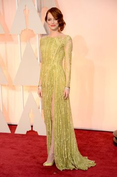 In an unexpected move, Emma opted for a chartreuse custom Elie Saab gown in 2015. Image Source: Getty / Kev...