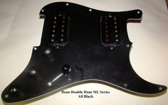 THIS IS A FULLY LOADED, WIRED, AND READY TO INSTALL BLACK PICKGUARD FOR FENDER STRAT.Loaded Pickguard #3351.The installed pickups are the same hot humbuckers as those used in the Dean ML Series Guitars.Product Description:WIRED ASSEMBLY FOR STRAT®The following pickups are used in this assembly:Two Dean SAR HumbuckersDC Resistance:Neck 9.68KBridge 11.1KThis pickguard is wired with a three way switch allowing selection of Bridge, Neck, or both pickups.Each pickup has its own volume control…