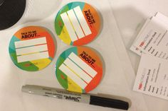 """At TEDActive in Palm Springs, buttons with blank fields labeled """"Talk to Me About ... """" invited guests to write a short list of topics they ..."""