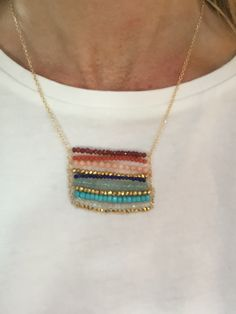 Details This beautiful Boho-Chic pendant necklace features layers of colorful gemstone beads: garnet, coral, peach coral, lapis, light apatite, turquoise, moonstone, and gold pyrite. The gold-filled c