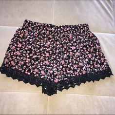LA Hearts floral lace trim shorts. LA Hearts. Floral shorts. Black lace/crochet trim. Flowy/comfy fit. Elastic waistband. Pockets. Cotton. Large. Preloved but good condition! LA Hearts Shorts