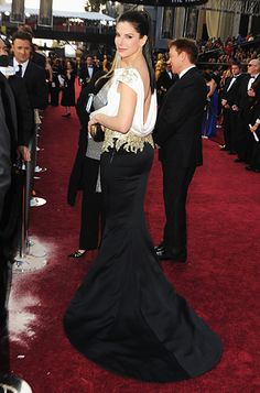 Sandra Bullock turned heads in a dramatic black and white Marchesa design and added the label's jeweled minaudiere, tiered danglers and a floral cocktail ring.