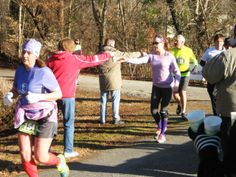 Runners reach for refreshing drinks during the Roanoke Canal Half-Marathon/8K.