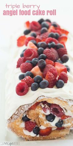 This Triple Berry Angel Food Cake Roll is an easy red, white and blue dessert (or just red and white!) for the 4th of July or Canada Day, or any day! Perfect with fresh summer strawberries, raspberries and blueberries :) Includes step by step recipe video. | 4th of july | july 4 | Canada Day | summer dessert | fresh fruit | easy dessert | cake mix #dessertfoodrecipes