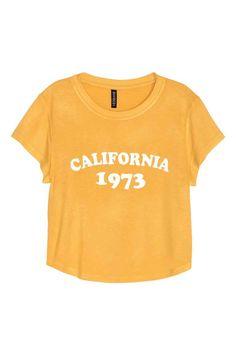 Camiseta corta de punto: Camiseta corta y ancha en punto con motivo estampado. Mangas cortas.