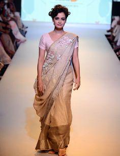 Dia Mirza in a sari as she walked the ramp for designer Anavila Mishra at Lakme Fashion