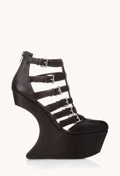 Bold Heel-Less Wedges   FOREVER21 Today, we're going heel-less #Wedges #HeelLess #Capsule #FauxLeather #Buckles