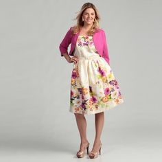 f36c6db9c86b @Overstock - This lovely dress from Jessica Howard features a classic  floral print and belted