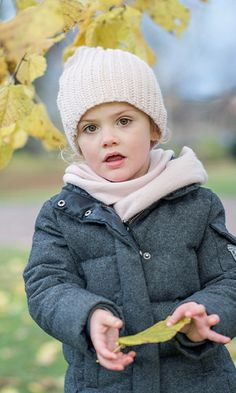 November 2015: The fashionable youngster bundled up against the autumn chill in a padded grey coat with a knitted pink hat and matching scarf.<br><p>Photo: © Kate Gabor/Kungahuset.se</p>