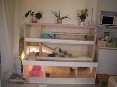 mansion made out of hacked Ikea cupboard parts and shelves