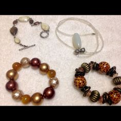 Bundle of costume jewelry Three bracelets and one necklace. All in great condition. The necklace has a stone that is ivory in color but matches well with the green colored bracelet (see pic #2). Jewelry Bracelets