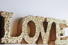 GOLD LOVE SIGN Glittered Golden Love Letters Signage Free Standing Vintage Weddings Resin Candy Buffet Valentine's Day Valentine Photo Prop by DesignsByEmbellish on Etsy https://www.etsy.com/listing/216492027/gold-love-sign-glittered-golden-love: