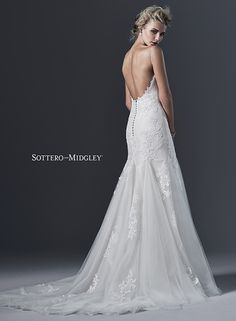 Stunning simplicity is found in this embroidered lace and tulle wedding dress, with slim A-line skirt. Sandrina by Sottero and Midgley.