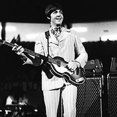 Beatle Paul McCartney with his 2nd Hofner violin bass onstage at Olympia Stadium in Detroit, Michigan, Aug. 13, 1966. Notice the pick guard is in place at this point.