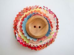 Flower fabric brooch with wooden button detail £8.75