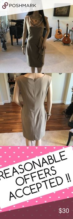 """Calvin Klein Bodycon Ruffle Trim Dress Like New!! Hey Fashionistas! Check out this chic and sophisticated piece that's perfect for the office! Terrific solo or paired with a cardigan for a chilly evening. Like new condition! Cowl neck and ruffle detail at waist. Lots of visual interest and a real head turner! 20"""" back zip, and back kick pleat. 17"""" under arms, 15"""" waist, 18.5"""" hem, 37"""" shoulder to hem. Please review photos and description closely prior to purchase. Be sure to check back often…"""