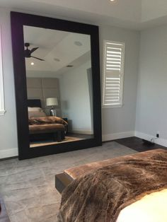 Leaning mirror fabricated by Rustic Rooster