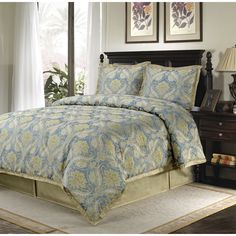Enhance your bedroom decor with the charming Sullivan 4-piece comforter set. The comforter and shams feature a jacquard pattern in shades of warm sage, green and ivory on a soft slate blue background.