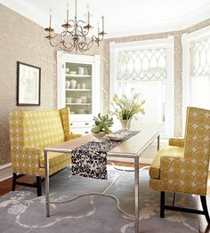 In this dining room, the patterns themselves are on the subtle side, but the brave combination of damask wallpaper, graphic upholstery and floral rug create a winning dining room.