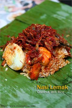 Nasi Lemak (Malaysian Coconut Milk Rice): Nasi Lemak is the de-facto national dish of Malaysia. Nasi Lemak is usually served in the morning as breakfast. The toppings include anchovies sambal, hard-boiled eggs, fried fish and shrimp. Other common toppings include roasted peanuts and cucumber slices.