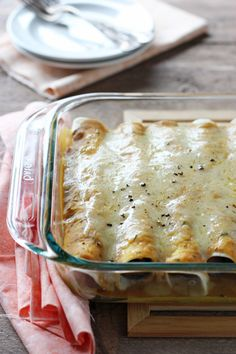 Recipe for butternut squash enchiladas. With a creamy butternut squash sauce and filled with sausage, mushrooms and spinach. Fall-inspired enchiladas!