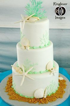 Mint green beach wedding cake.