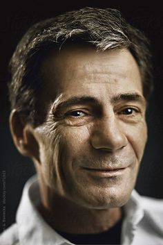 Closeup studio portrait of a handsome middle age man  by Stalman & Boniecka