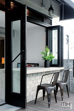 Love entertaining space/bar with window that opens to outside in den addition.