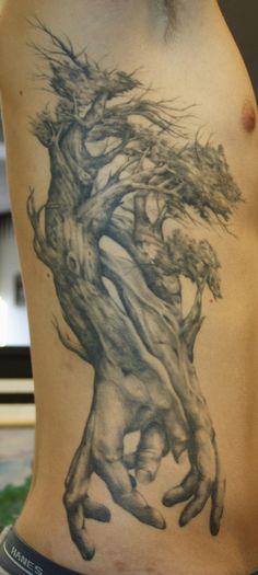 Tree root hands tattoo.