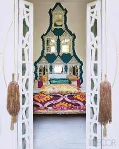 Liz Bruce's Morrocan Home.. fashion designer Liz Bruce's Moroccan oasis that blends tribal artifacts with exuberant color on elledecor.com.